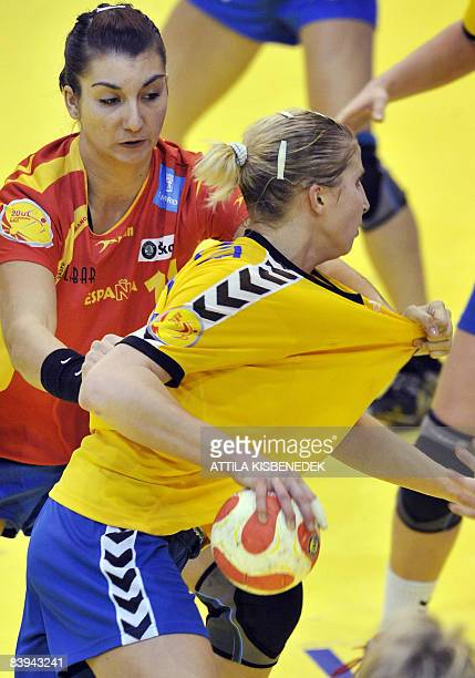 Ukrainian Rehina Shymkute is fouled by Spanish Elisabet Chavey during the 8th Women's Handball European Championships match on December 7 2008 in...