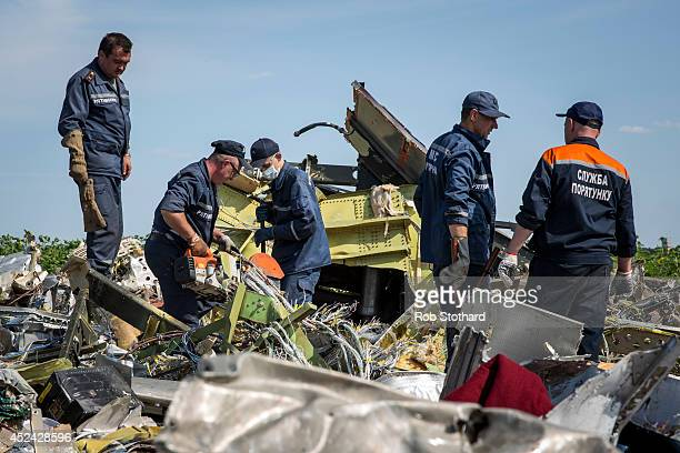 Ukrainian rescue servicemen inspect part of the wreckage of Malaysia Airlines flight MH17 on July 20 2014 in Rassipnoye Ukraine Malaysia Airlines...