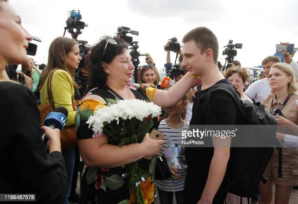 Ukrainian Sailor Vyacheslav Zinchenko CommanderSignalman who was jailed in Russia stands with his relative upon arrival during a welcoming ceremony...