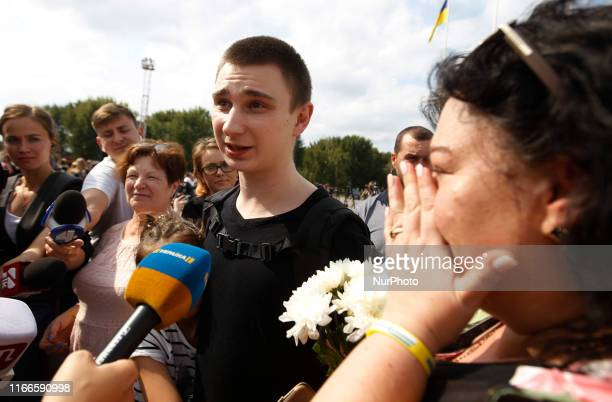 Ukrainian Sailor Vyacheslav Zinchenko CommanderSignalman who was jailed in Russia speaks to journalists as his a relative reacts upon arrival during...