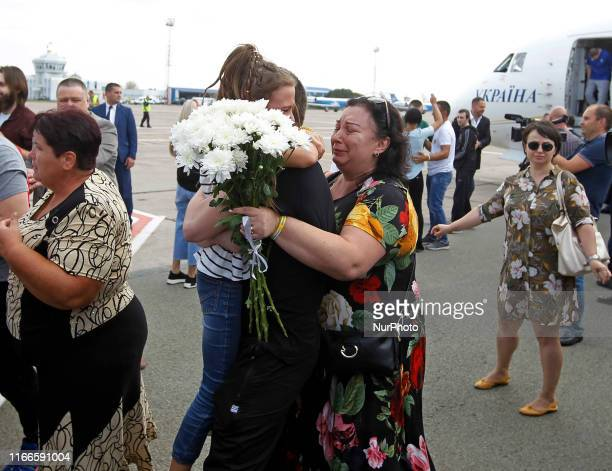 Ukrainian Sailor Vyacheslav Zinchenko CommanderSignalman who was jailed in Russia hugs with his relative upon arrival during a welcoming ceremony...