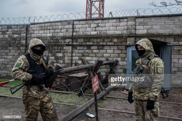 Ukrainian sea border security soldiers man a checkpoint at the Mariupol Port as Ukraine's navy mobilises on the Azov Sea on November 28 2018 in...