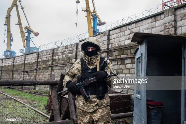 Ukrainian security force soldier guards Ukraine's Mariupol Port on the Azov Sea on November 28 2018 in Mariupol Ukraine Ukrainian President...
