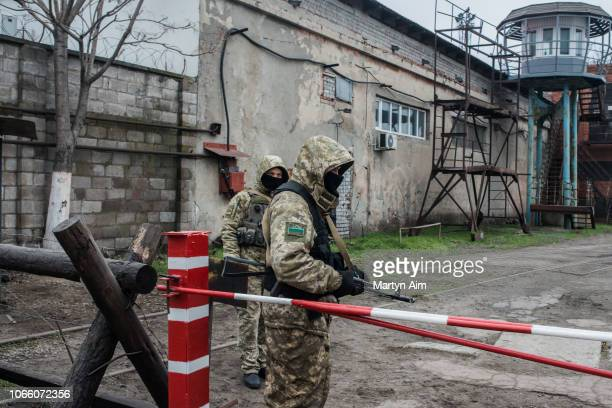 Ukrainian security force soldiers guard a checkpoint at the entrance to Mariupol Port on the Azov Sea on November 28 2018 in Mariupol Ukraine...