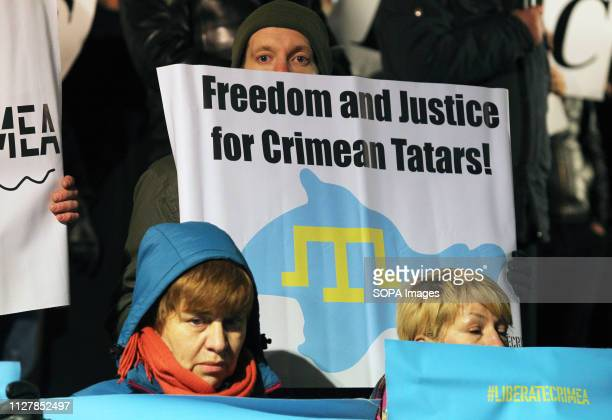 Ukrainian seen holding a placard saying freedom and justice for crimean Tatars during the rally Ukrainians rally marking the fifth anniversary of...