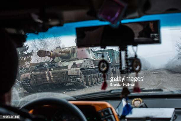 Ukrainian self-propelled gun drives on the road away from the embattled town of Debaltseve on February 14, 2015 in Artemivsk, Ukraine. A ceasefire...