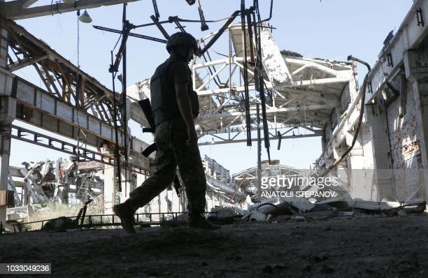 A Ukrainian serviceman attends at ruins of industrial zone on the front line with Russiabacked separatists uptown of Avdiivka Donetsk region on...
