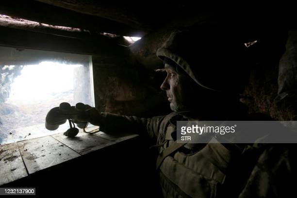 Ukrainian serviceman holds a position at the front line with Russia-backed separatists not far Avdiivka, Donetsk region on April 5, 2021.