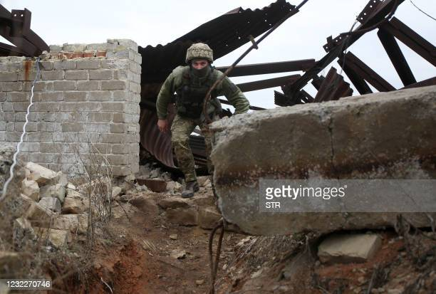 Ukrainian serviceman patrols at a position on the frontline with Russia backed separatists near small city of Marinka, Donetsk region on April 12,...