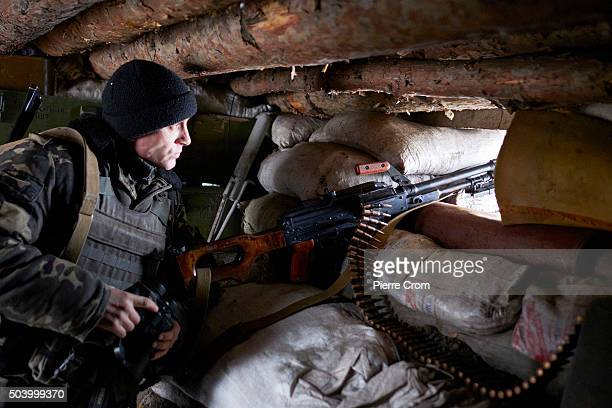 Ukrainian serviceman stands guards in a trench in the frontline city of Avdiivka as Ukrainian forces pushed back an attack by proRussian rebels on...