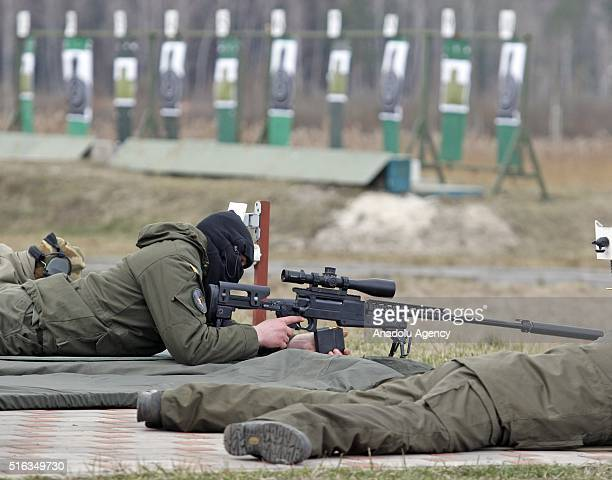 Ukrainian servicemen attend the handover ceremony of small arms for snipers at the Training Center of the National Guard near the village of Novi...