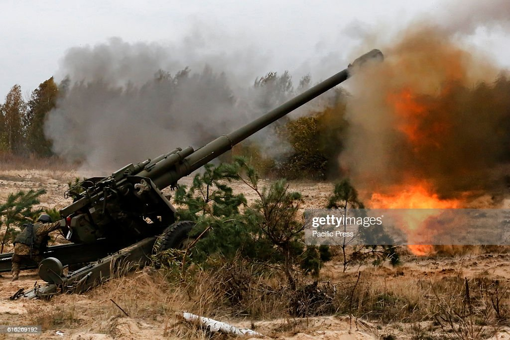 Ukrainian servicemen fire a 152mm 'Msta B' howitzers during a military exercises on the Devichki shooting range, about 85 km of capital Kyiv, Ukraine.
