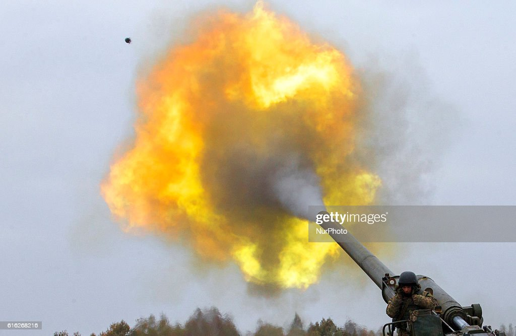 Ukrainian servicemen fire a 203mm self-propelled gun 'Pion' during a military exercise on the Devichki shooting range, about 85 km of capital Kyiv, Ukraine, 21 October 2016.