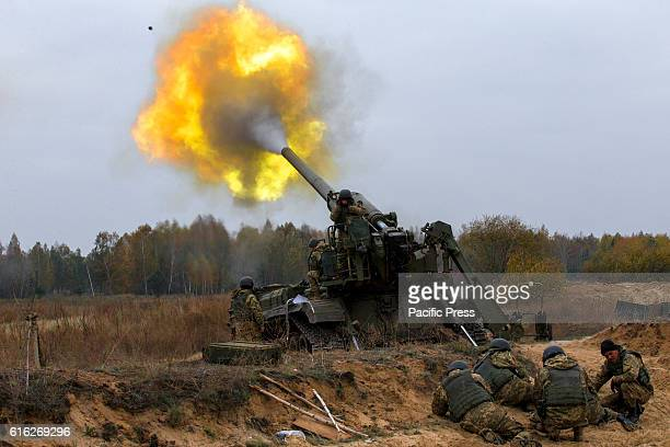 Ukrainian servicemen fire a 203mm selfpropelled gun 'Pion' during a military exercises on the Devichki shooting range about 85 km of capital Kyiv...