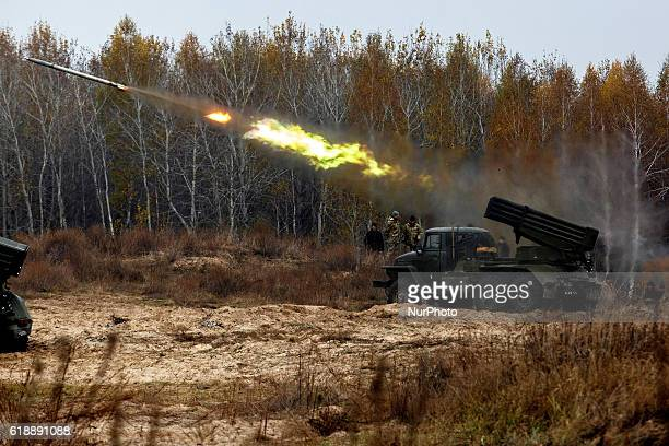 Ukrainian servicemen fire BM21 Grad multiple rocket launcher systems during military exercises near the village of Divychky in Kyiv region Ukraine...