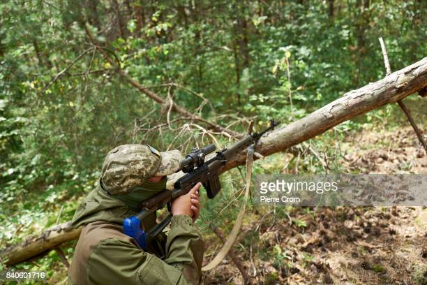 Ukrainian servicemen from a sniper brigade train at the Yavoriv training center on August 29 2017 in Starychi Ukraine Training of Ukrainian troops...