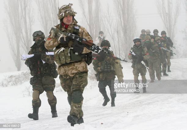Ukrainian servicemen of the Donbass volunteer battalion take part in cleanup operations in a village in the Lysychansk district of the Lugansk region...