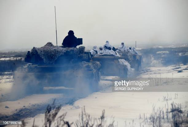 TOPSHOT Ukrainian servicemen on armored personal carriers take part in brigade tactical exercises with combat shooting near Goncharivske willage...