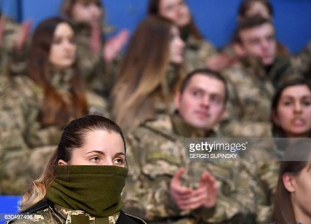Ukrainian servicemen react during the final competition in the CrossFit Games 'Games of the Heroes' in Kiev on December 24 2016 Some fifteen...