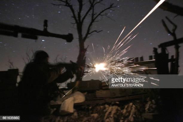 TOPSHOT Ukrainian servicemen shot with machine guns during fighting with proRussian separatists in Avdiivka Donetsk region on March 31 2017 US...