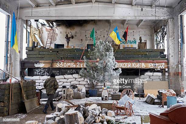 Ukrainian servicemen walk about their shelter as they hold a position in the frontline village of Pisky during ongoing fights between Ukrainian...
