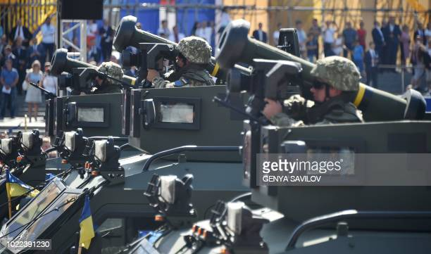 Ukrainian servisemen ride atop of an APC's with Javelin antitank missiles during a military parade in Kiev on August 24 2018 to celebrate the...