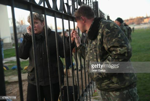 Ukrainian soldier at the Belbek military base talks to his mother through the base's fence on March 3, 2014 in Lubimovka, Ukraine. Tensions at the...