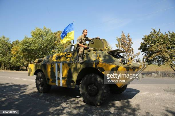Ukrainian soldier heads to a frontline position on the outskirts of the strategic coastal city of Mariupol following an evening of heavy shelling by...