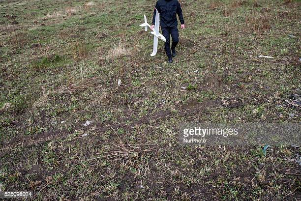 Ukrainian soldier of Azov Battalion of Ukrainian Special Forces holds crashed drone used for training controlling unmanned aerial vehicle in the...