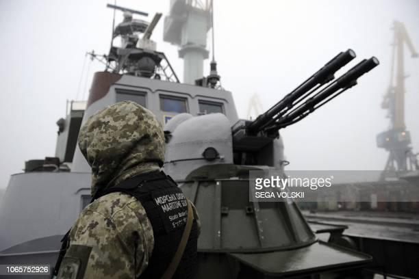 TOPSHOT Ukrainian soldier patrols aboard military boat called Dondass moored in Mariupol Sea of Azov port on November 27 2018 Three Ukrainian navy...