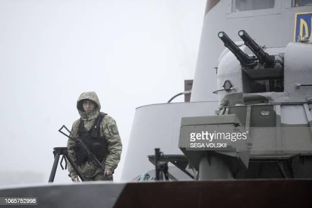 Ukrainian soldier patrols aboard military boat called Dondass moored in Mariupol Sea of Azov port on November 27 2018 Three Ukrainian navy vessels...