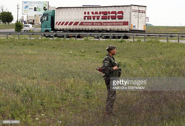 Ukrainian soldier secures an area outside the southern city of Odessa on May 9, 2014. Russian President Vladimir Putin took a victory lap in his...