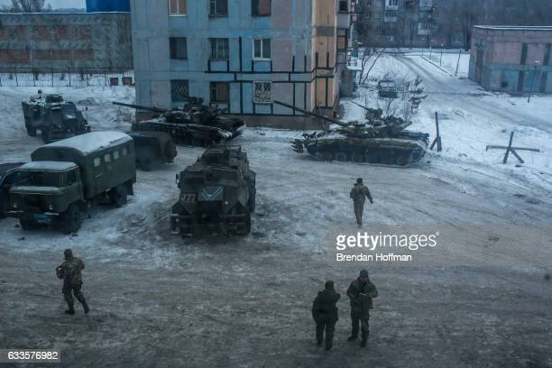 Ukrainian soldiers and tanks outside a building used as a base on February 2 2017 in Avdiivka Ukraine The conflict in the frontline town with...