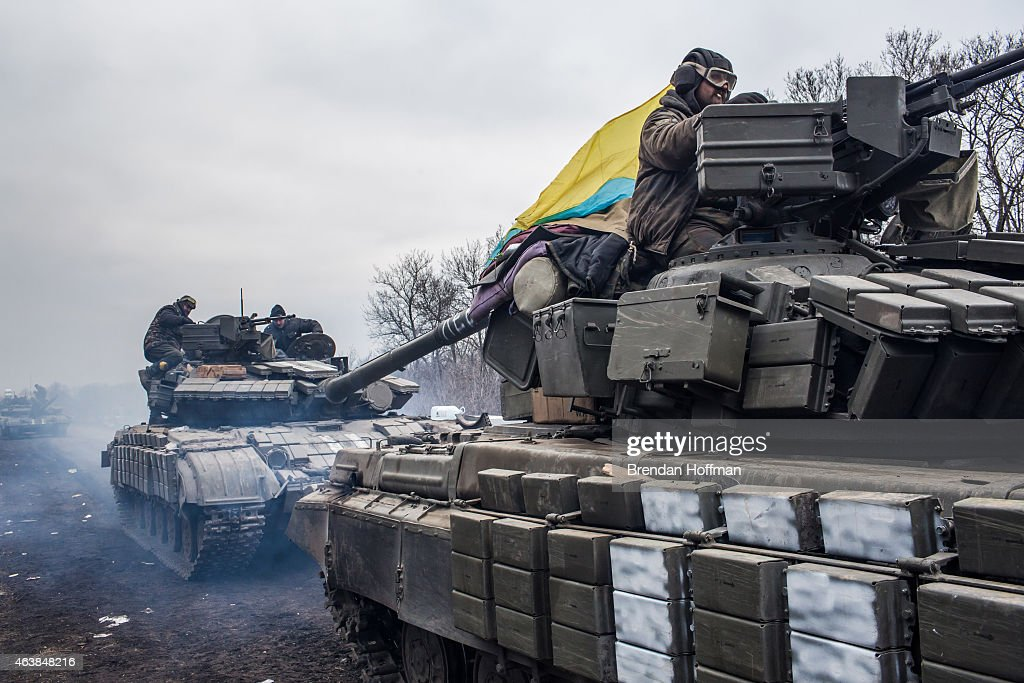 Ukrainian soldiers drive tanks along the road leading out of Debaltseve on February 19, 2015 in Artemivsk, Ukraine. Ukrainian forces have begun withdrawing from the strategic and hard-fought town of Debaltseve after being effectively surrounded by pro-Russian rebels.