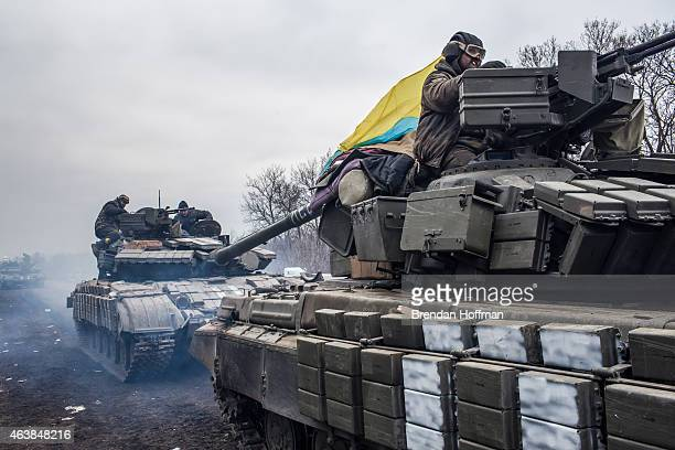 Ukrainian soldiers drive tanks along the road leading out of Debaltseve on February 19, 2015 in Artemivsk, Ukraine. Ukrainian forces have begun...