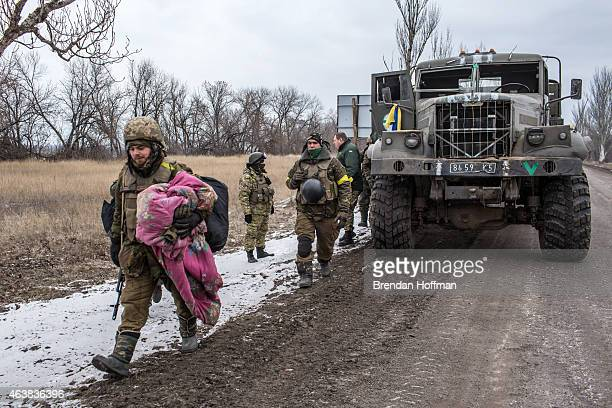 Ukrainian soldiers from a unit based in Zaporizhia gather their belongings after withdrawing from Debaltseve on February 19, 2015 in Artemivsk,...