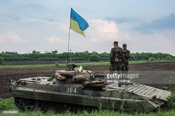 Ukrainian soldiers guard a checkpoint on May 14 2014 in Novatroizk Ukraine ProRussian militants ambushed Ukrainian troops nearby the day before...