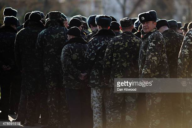 Ukrainian soldiers line up ahead of a morning drill inside the Belbek military airbase on March 14 2014 in Belbek Ukraine As the standoff between the...