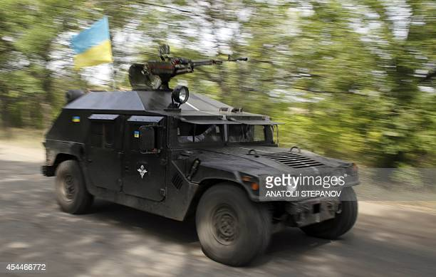 Ukrainian soldiers patrol in a APC in the Donetsk area on September 1 2014 Ukrainian troops have retreated from the Lugansk airport and a nearby...