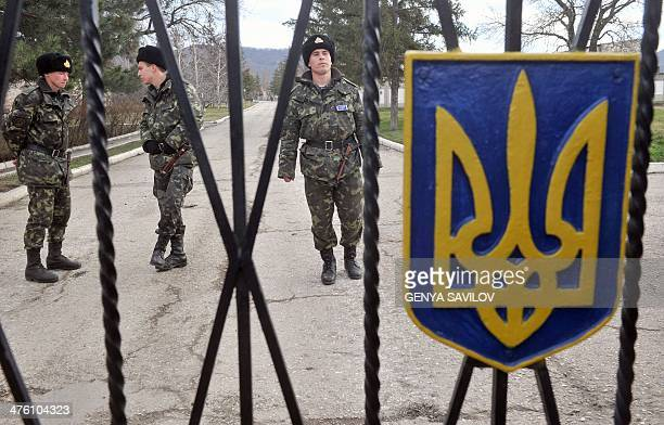 Ukrainian soldiers stand guard inside a border guards base not far from the village of Perevalne near Simferopol on March 2 2014 About 1000 armed men...