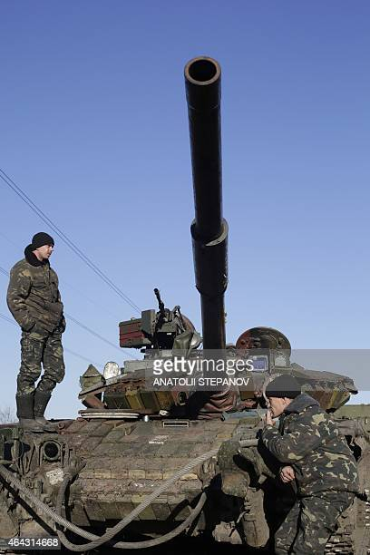 Ukrainian soldiers stand next to a tank at a checkpoint near Gorlivka on February 24 2015 Foreign ministers from Ukraine Russia Germany and France...