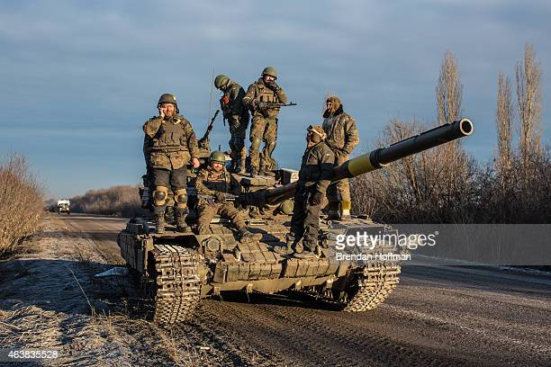 Ukrainian soldiers who left Debaltseve yesterday prepare to return to support the further withdrawal of troops on February 19 2015 in Artemivsk...