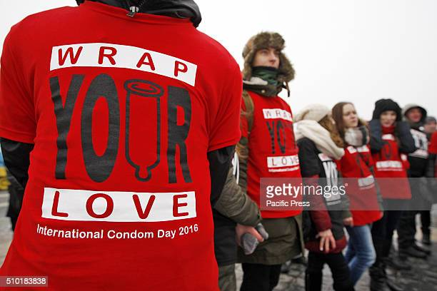 Ukrainian students and volunteers during a flash mob called 'Wrap your love' as they mark the International Condom Day at World War II open air...