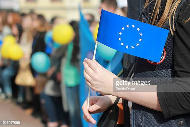 Ukrainian students form a live chain during performance named ''Ukraine and Europe stronger together'' in front of the Dutch embassy in Kiev...