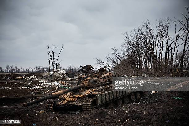 Ukrainian tank sits destroyed in an entrenched battlefield where the Ukrainian army was defeated by proRussian rebels on March 2 2015 on the...