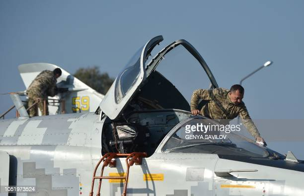 Ukrainian technicians prepare SU24 planes during an air force exercises on Starokostyantyniv military airbase on October 12 2018 The largescale air...