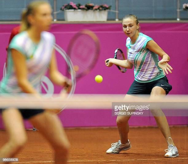 Ukrainian tennis playars Lyudmyla Kichenok and Nadiya Kichenok play against Australian Anastasia Rodionova and Rennae Stubbs during their Fed Cup...