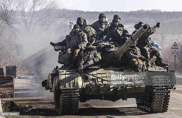 Ukrainian troops retreat from the eastern Ukrainian city of Debaltseve in the Donetsk region where the clashes take place despite ceasefire agreement...