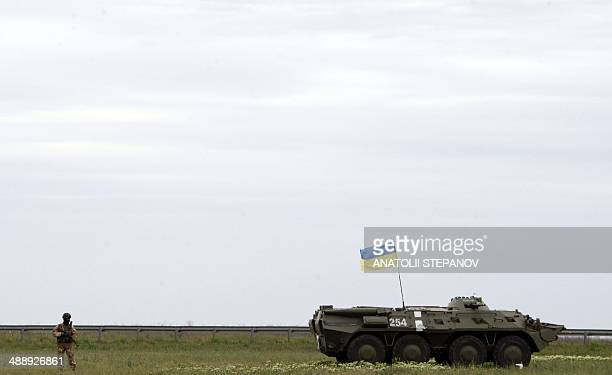 Ukrainian troops secure an area outside the southern city of Odessa on May 9, 2014. Russian President Vladimir Putin took a victory lap in his first...