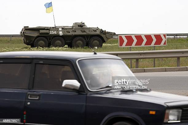 Ukrainian troops take position with an armoured personnel carrier outside the southern city of Odessa on May 9, 2014. Russian President Vladimir...